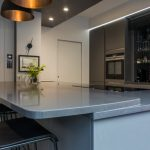 Kitchen Island Extended to accommodate sitting area at a higher level in grey colour Merengo Modern